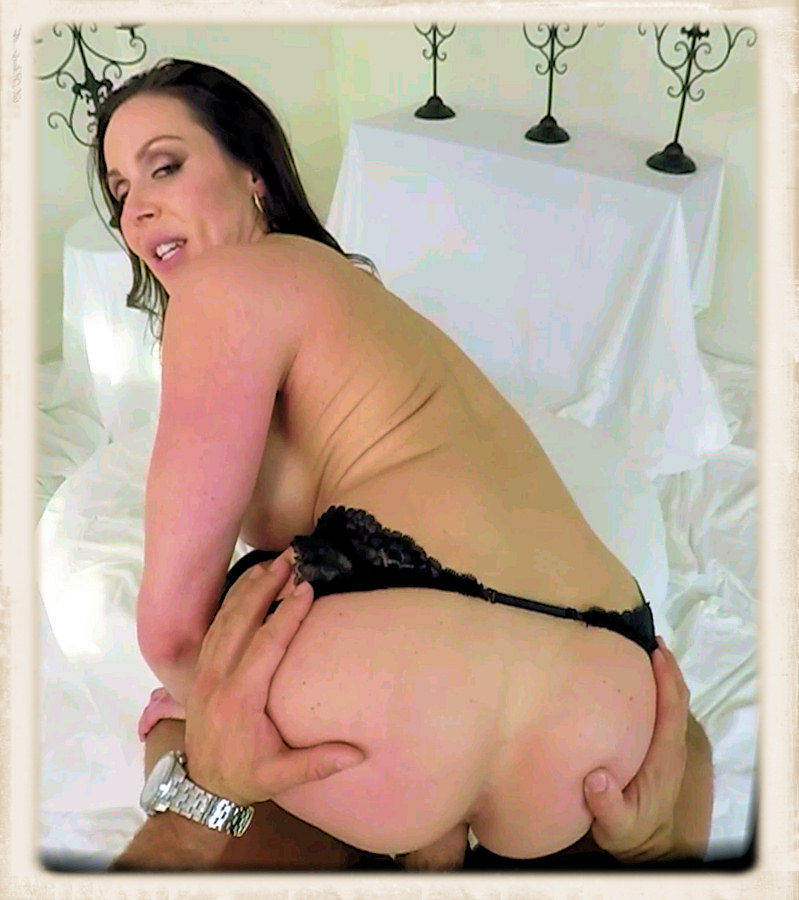 Kendra Lust looks back while doggied