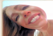 Nicole Aniston smiles