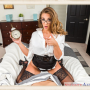 Layla London holds a clock
