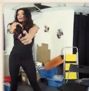 Anissa Kate points gun