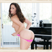 Tori Black pulls down her pink panties in this picture