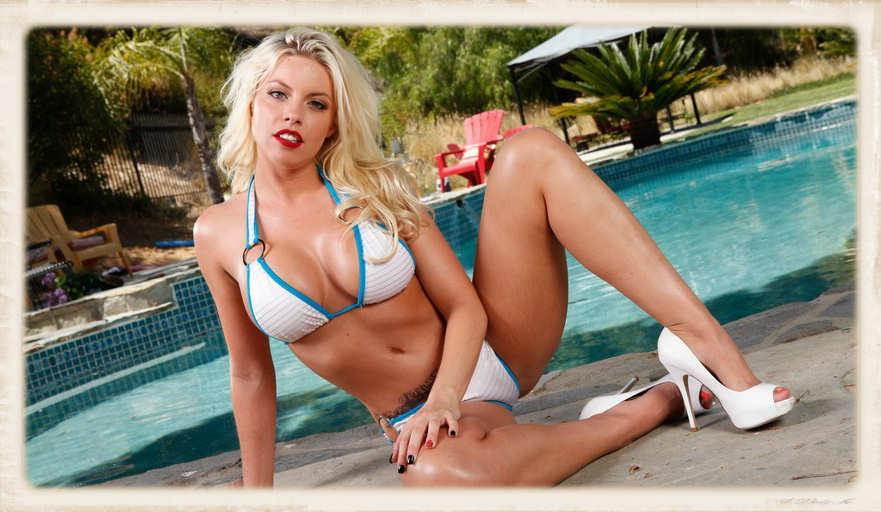Britney Amber relaxing in a horny blonde bikini