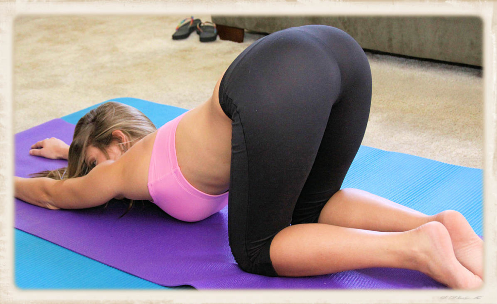 Yoga pants doggy pose