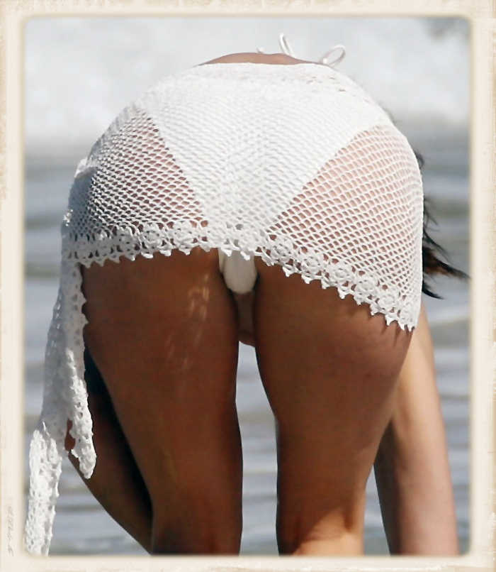 Stephanie Seymour bends over in a white bikini